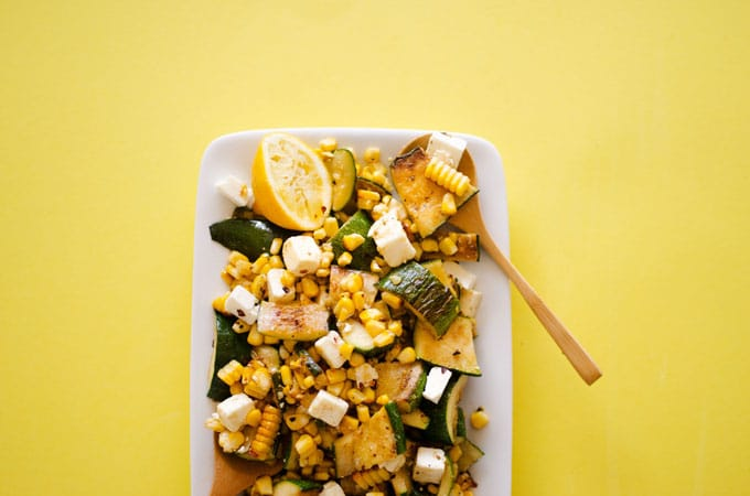 Zucchini Corn Salad with zingy lemon and feta cheese, so simple yet so perfect. This will become your new summer go-to dish.
