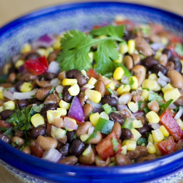 Ever since I can remember, my mom has always made this bean salad for any sort of neighborhood party or cookout. But it wasn't until I grew up a bit that I realized it's actually tasty and hey, pretty healthy too!