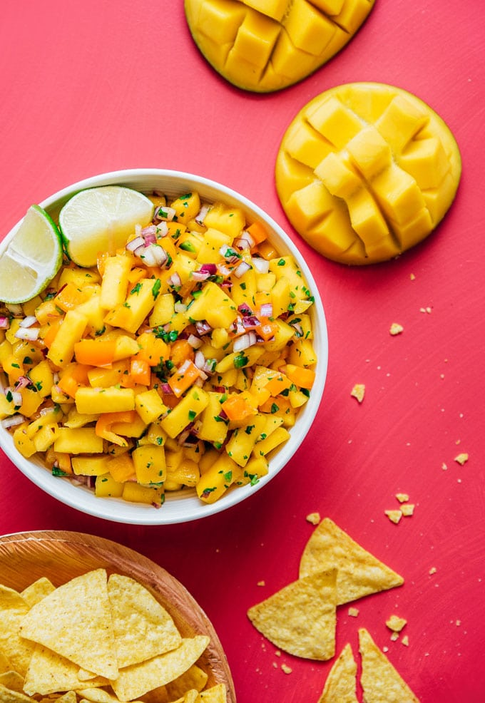 Fresh mango salsa recipe in a bowl with chips from above