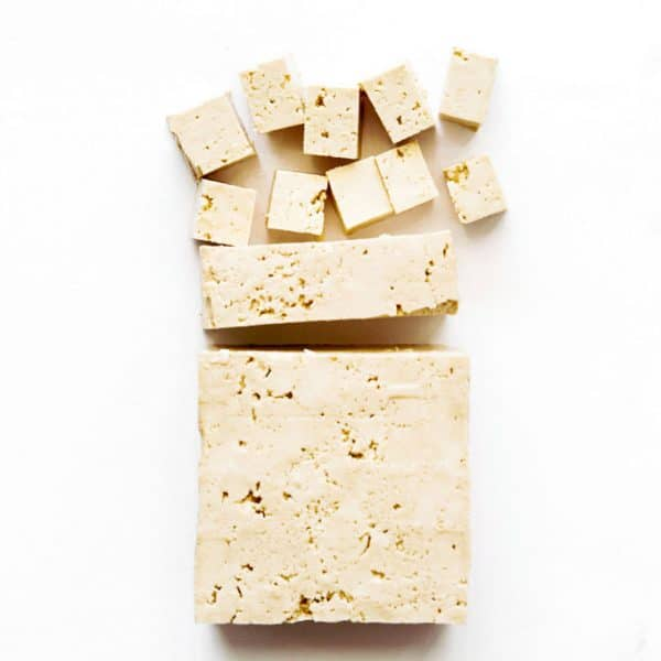 Photo of firm tofu on white background