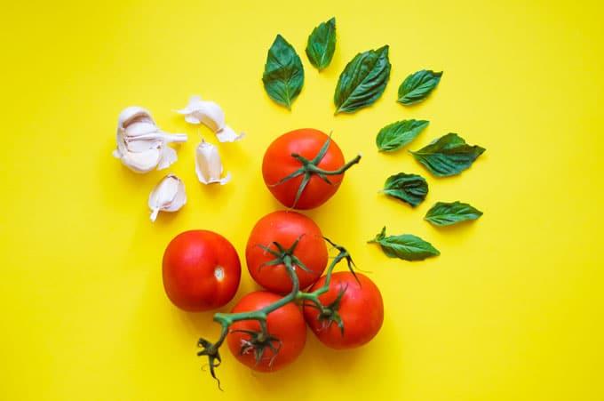 Ingredients to make marinara sauce with fresh tomatoes
