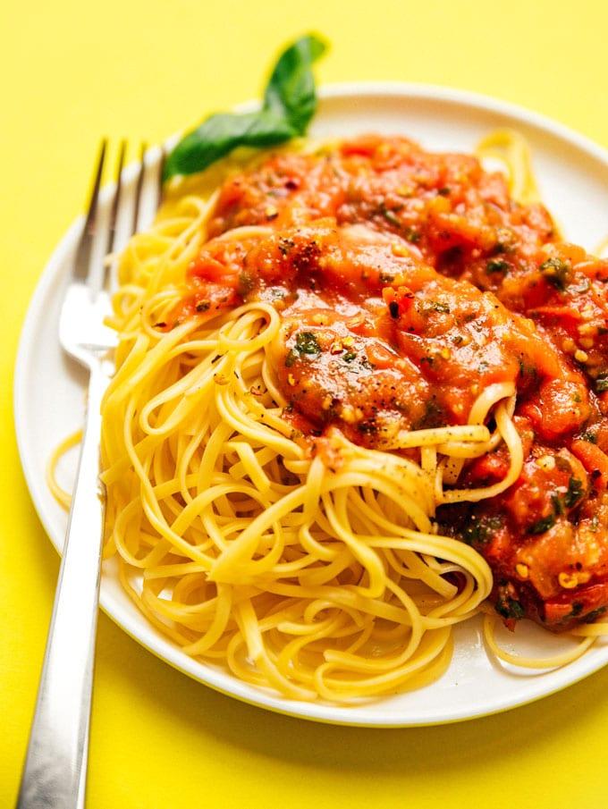 Homemade marinara sauce on a plate of spaghetti