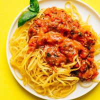 Homemade marinara sauce recipe on a plate of spaghetti