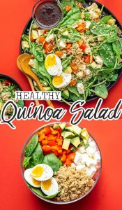 Mediterranean quinoa salad on a plate with serving spoons