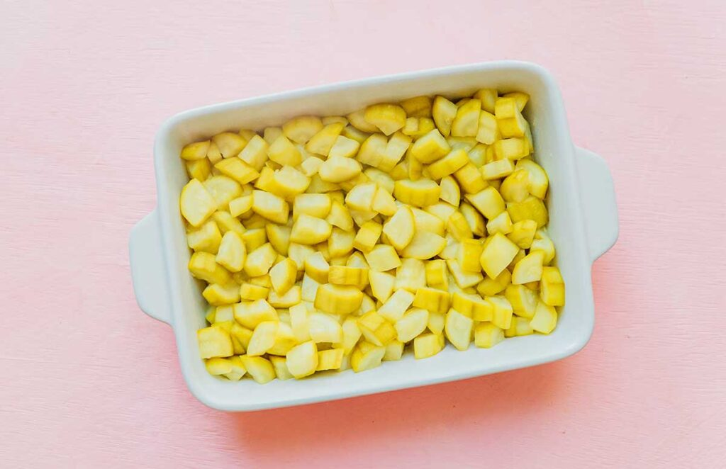 A casserole dish filled with cooked diced zucchini