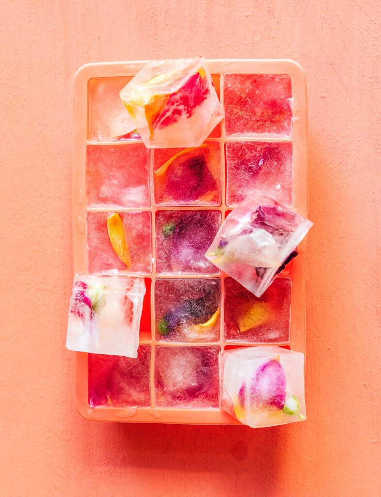 An ice cube tray filled with frozen edible flower ice cubes