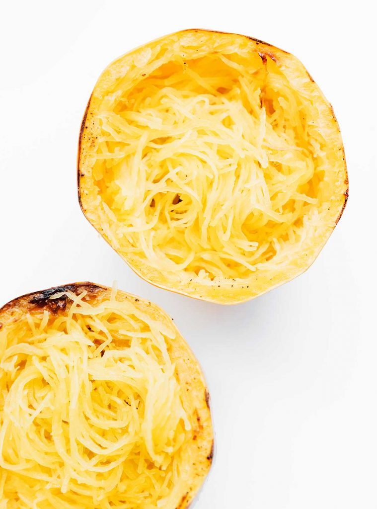 Cooked spaghetti squash on a white background