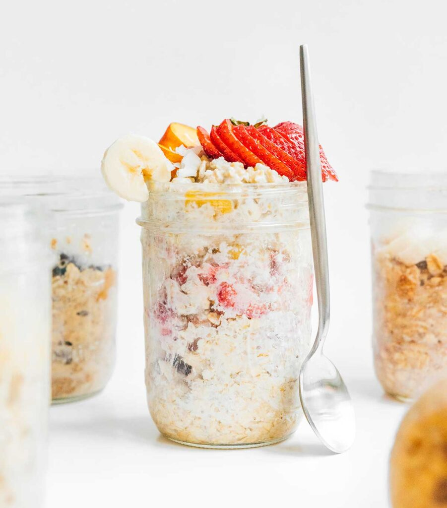 A mason jar filled with strawberries and cream overnight oats