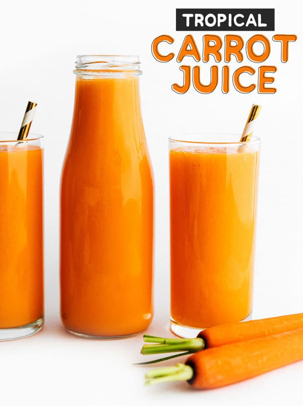 Carrot juice in a glass on a white background