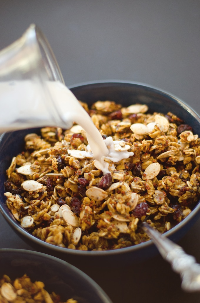 Double Pumpkin Granola in a bowl with milk being poured in