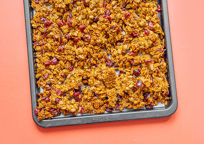 Pumpkin granola on a baking sheet