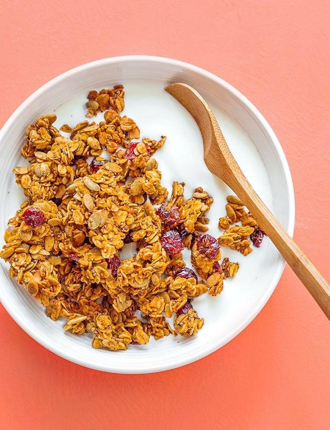 Pumpkin granola in a bowl with yogurt