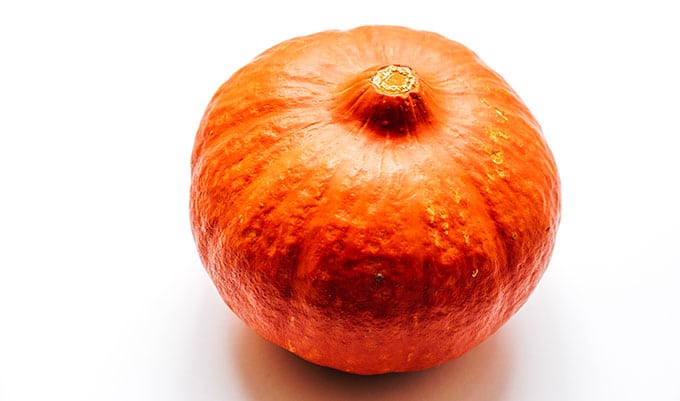 Small pumpkin on white background
