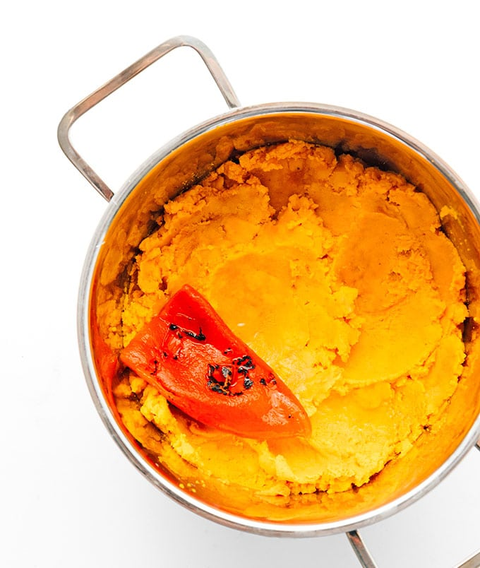 Ingredients to make pumpkin soup in a pot
