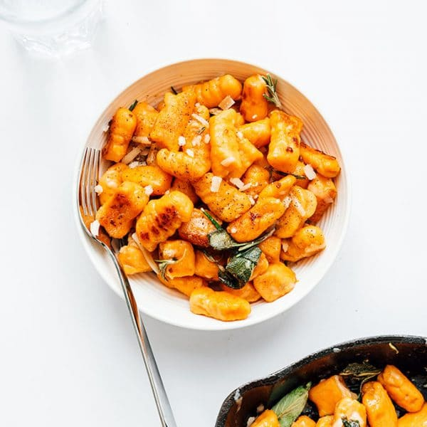 Sweet potato gnocchi in a bowl on a white background