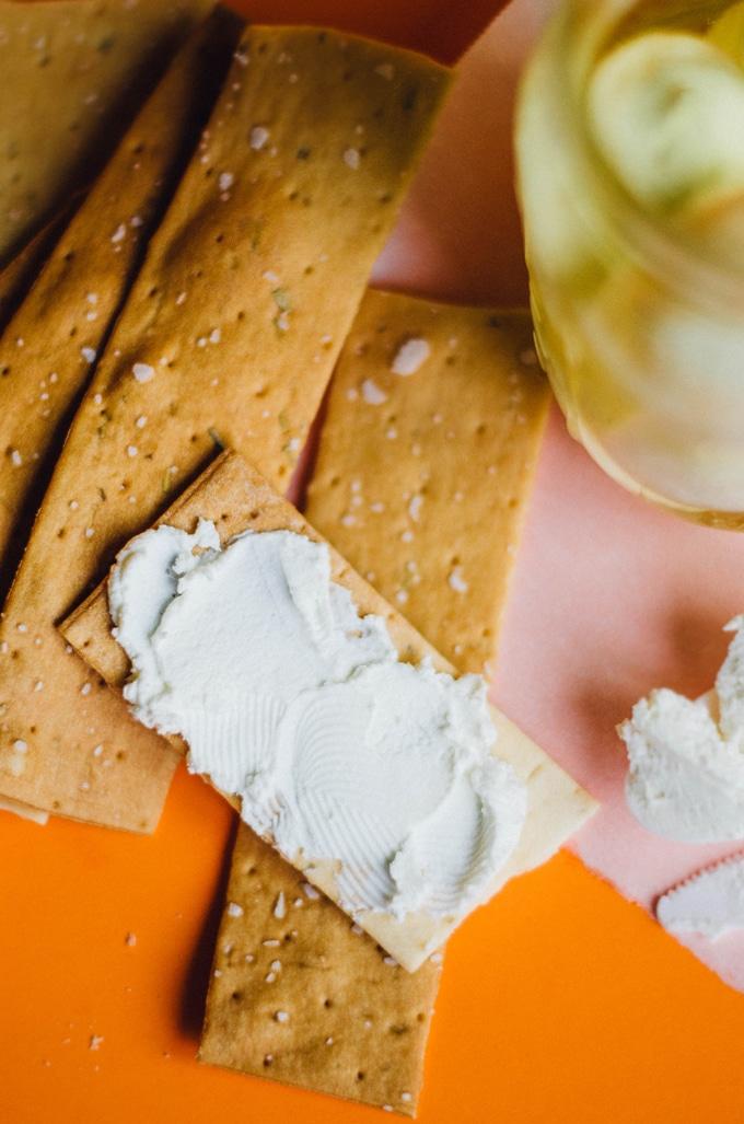 Greek Yogurt Cheese spread onto crackers