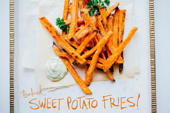 Baked sweet potato fries on marble background