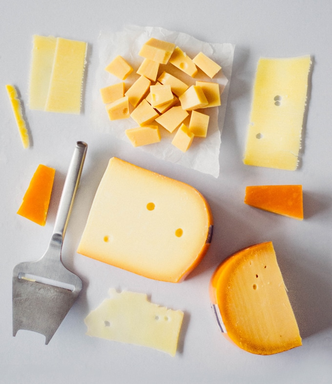 Different types of Gouda cheese in the rind and cut into blocks