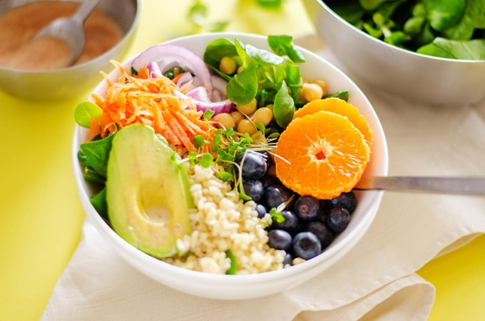 This 15 Minute Buddha Bowls recipe, with healthy grains, chickpeas, fruit, and avocado, is a balanced, healthy meal that comes together in no time!