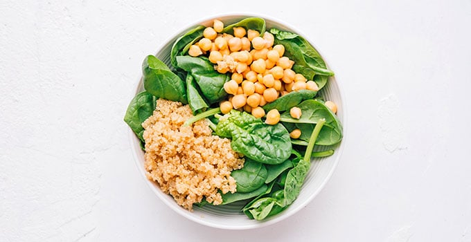 Chickpeas, quinoa, and spinach in a bowl