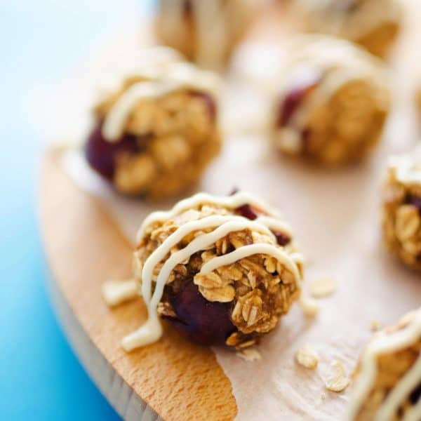 These cherry cheesecake energy bites are healthy, super delicious little oat cookies that come together in just 20 minutes! A banana oat base makes the cookies moist and chewy, while the cream cheese frosting adds the perfect amount of decadence.