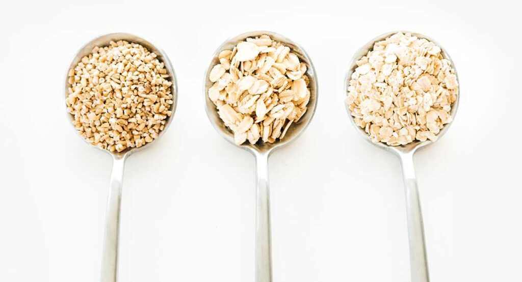 Different types of oats on spoons