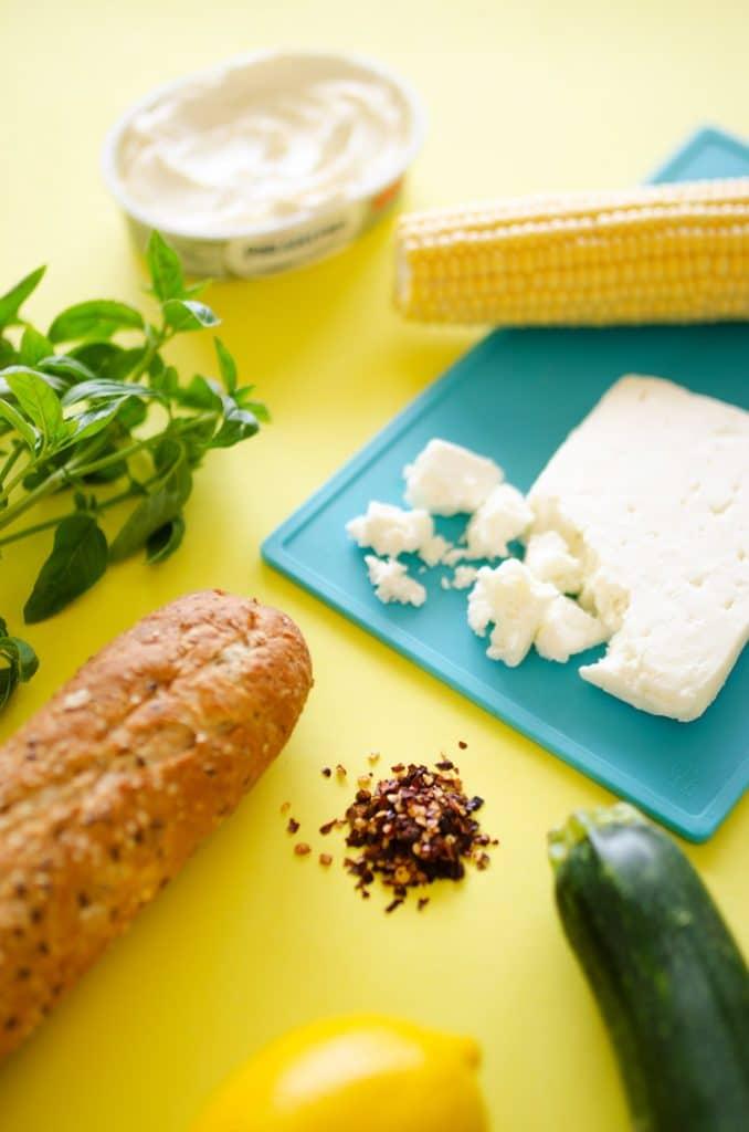Whipped Feta, Corn, and Zucchini Crostinis