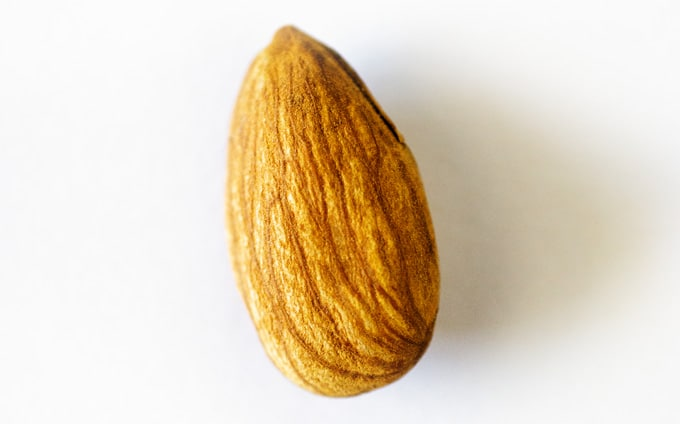 Close up photo of almond on white background