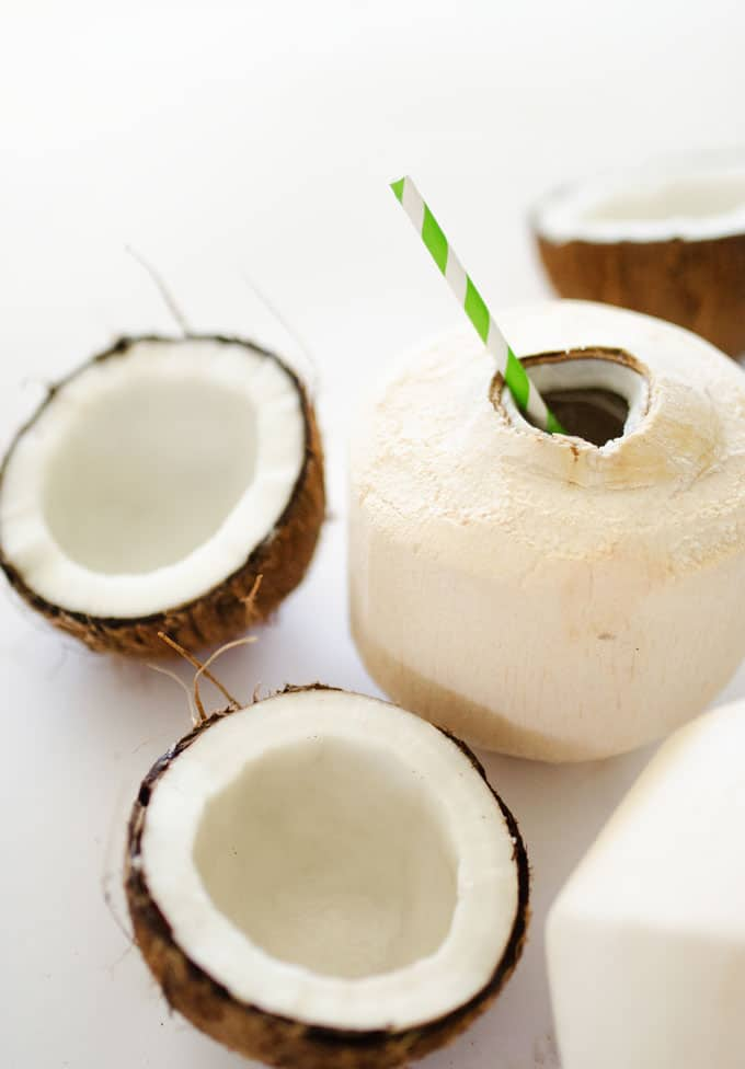 Picture of different kinds of coconuts on white background