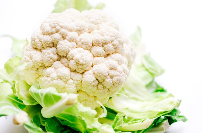 Head of cauliflower on white background