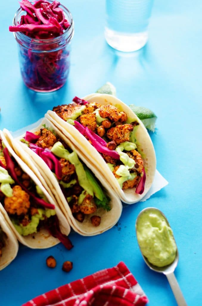 Cauliflower tacos with avocado sauce and red cabbage