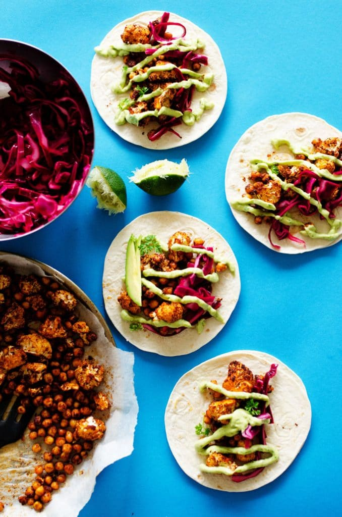 Cauliflower tacos with avocado sauce and red cabbage - These Roasted Cauliflower Tacos with quick slaw and avocado cream sauce are a quick and delicious way to load up on veggies this Taco Tuesday!