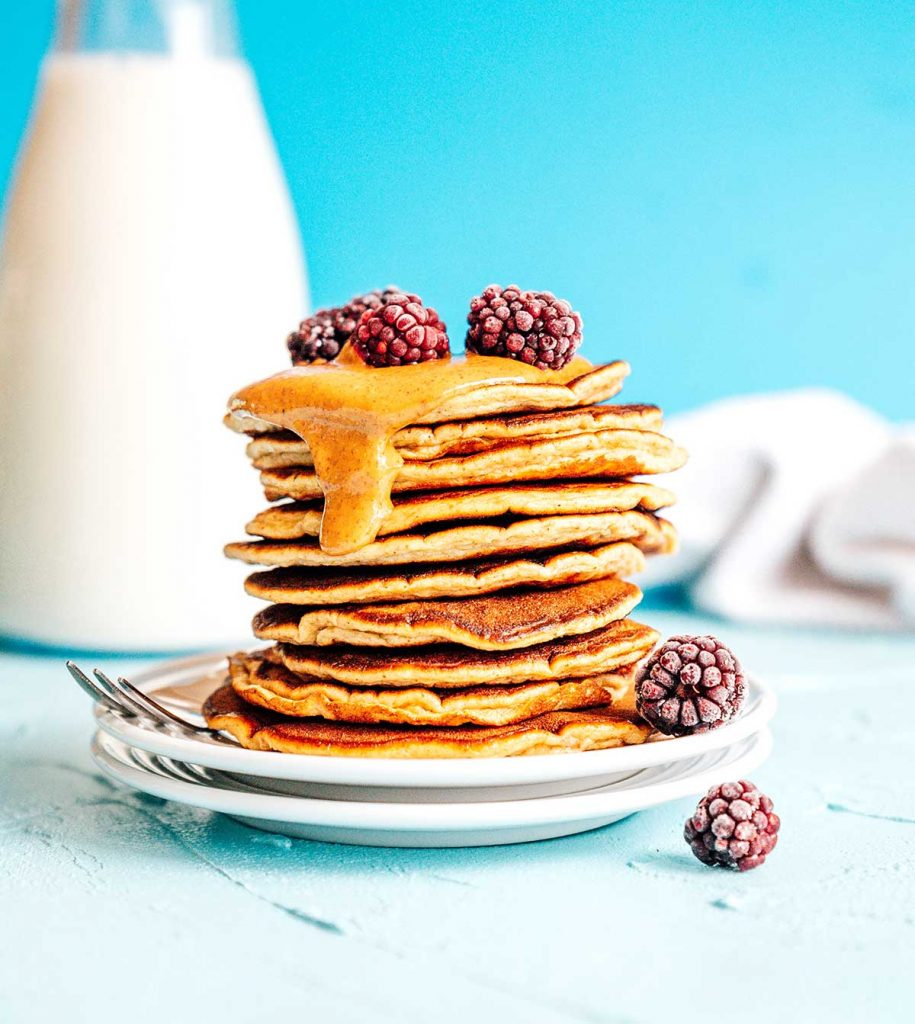 Paleo pancakes with almond butter on a blue background