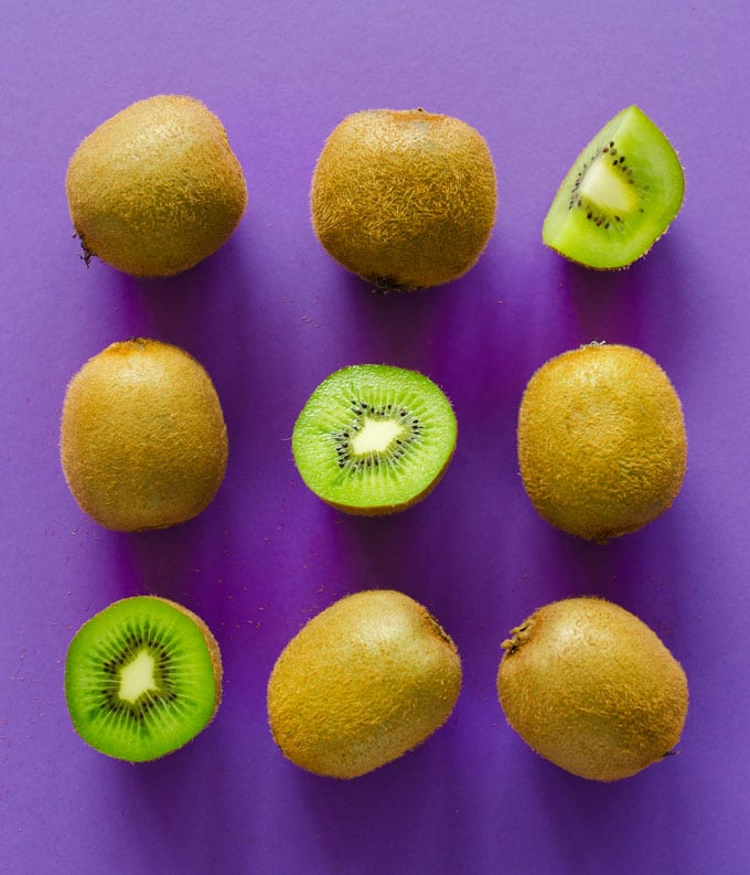 Picture of a kiwi on a purple background