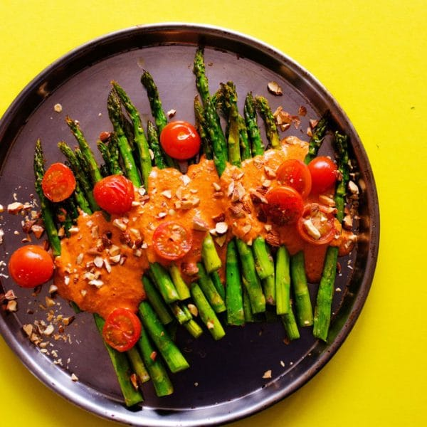 This Roasted Asparagus with Smoky Romesco Sauce is a simple, flavor-packed recipe that is sure to brighten up your dinner table with! With just 1 pan and I'm 30 minutes you'll have a show stopping side dish ready to go.