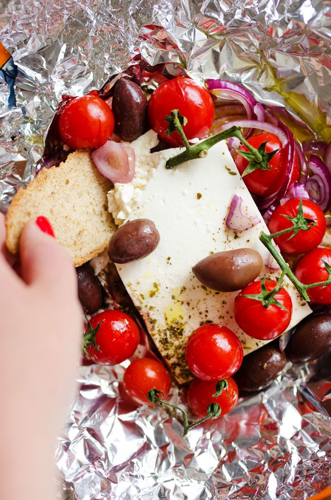 This Greek Baked Feta takes everything delicious about Greek salad and throws it in the oven for a few minutes!