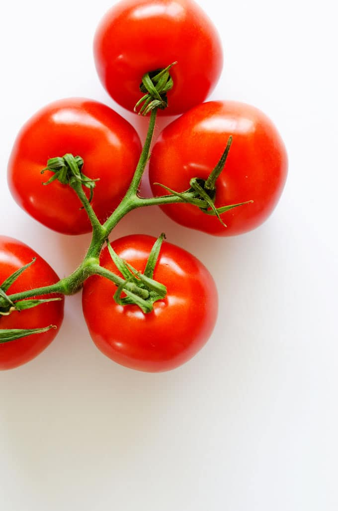 Everything you need to know about the many types of tomatoes! From heirlooms to hybrids, we're covering the cooking with tomatoes basics.Everything you need to know about the many types of tomatoes! From heirlooms to hybrids, we're covering the cooking with tomatoes basics.
