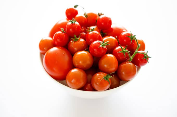 Cherry tomato variety on white background