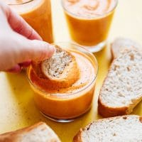 Romesco sauce recipe photo in a jar dipping bread