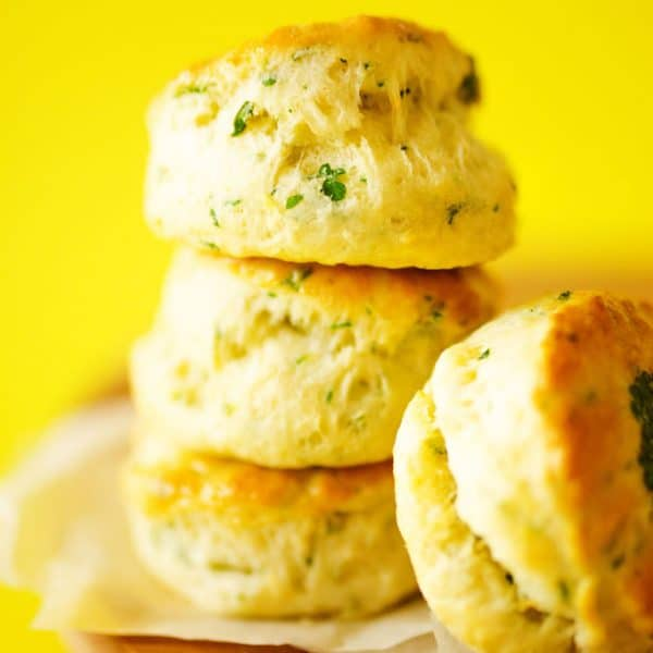 These Herby Greek Yogurt Biscuits are ultra-flaky with unique and delicious laminated herbs on top!