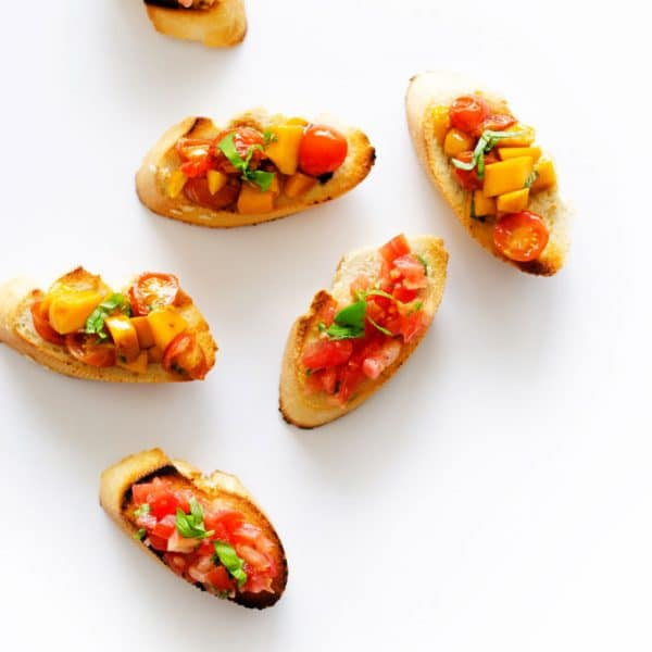 We're whipping up two kinds of bruschetta today: traditional and tomato mango bruschetta! Both are so easy and make the perfect healthy snack!