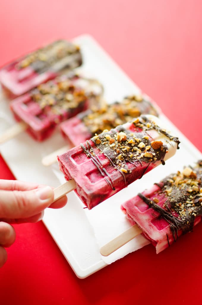These Chocolate Covered Cherry Yogurt Popsicles are an easy-to-make, healthy, and tasty treat to make this summer. If you need a reason to finally break out that old popsicle mold, this is it.