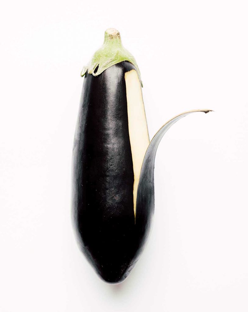 Peeling eggplant on a white background