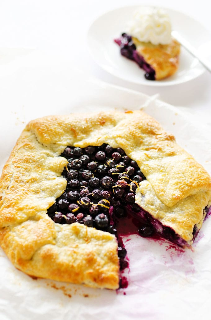 Blueberry galette with ricotta on a white background