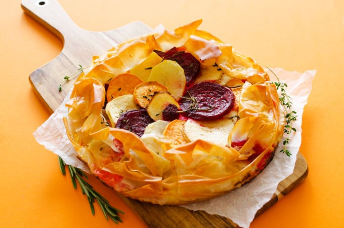 This Savory Apple Tart is a colorful, easy, and flavorful, dish with potatoes, beets, and apples in a flaky phyllo crust. It's sweet, it's savory, and it's calling your name.