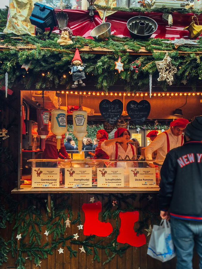 """If you like coziness and Christmas time, then you need to put """"go to a German Christmas market"""" on your bucket list. Here is your guide to navigating the delicious smells, tastes, and sights that make up German Christmas markets!"""