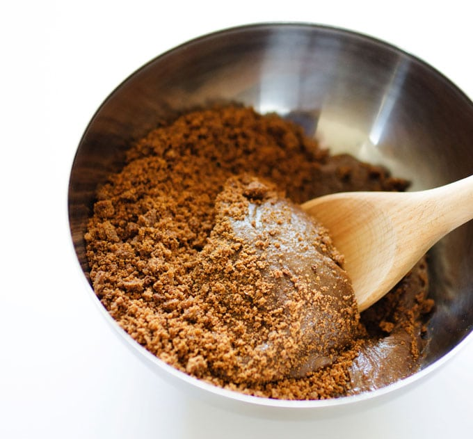 Stirring together speculoos cookie butter and cookie crumbs