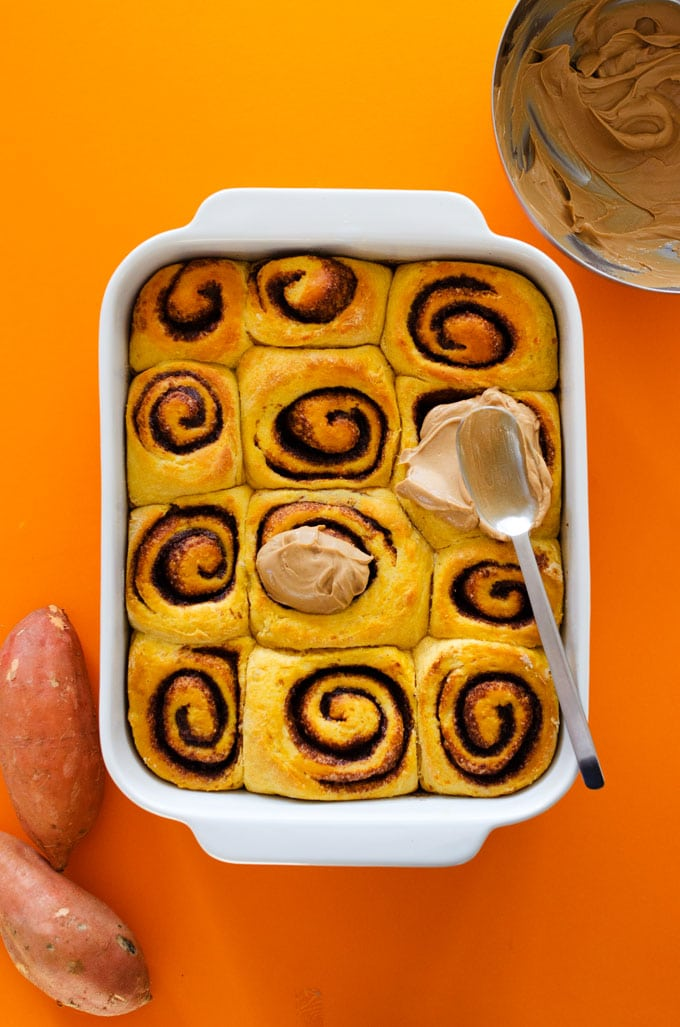 Cinnamon rolls in a pan with forsting - Fluffy, decadent, in slathered in a simple brown sugar cream cheese frosting, these Sweet Potato Cinnamon Rolls are the perfect way to wake up.
