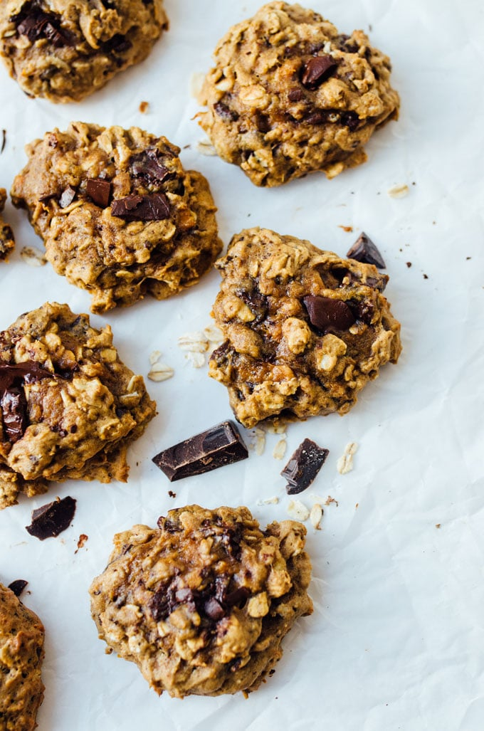 Oatmeal chocolate cookies on a pan - Need a healthy cookie recipe that's just as moist and delicious as your old favorites? This Sweet Potato Cookies recipe with chocolate and oats has you covered.