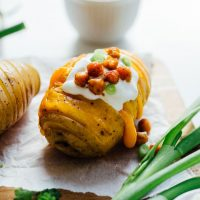 Change up the routine and make these easy hasselback potatoes for dinner tonight! We're whipping up three tasty flavors: vegan nacho, herb, and loaded.